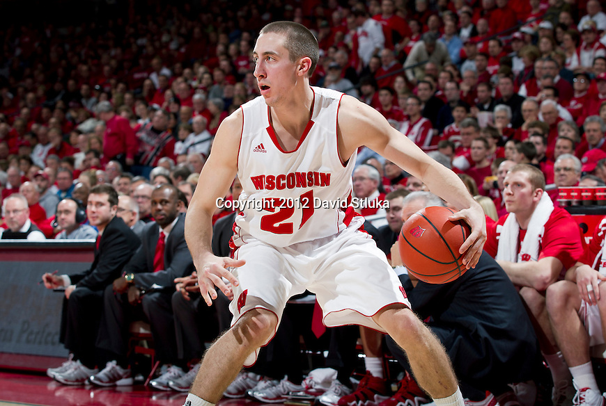 Wisconsin Badgers guard Josh Gasser (21) handles the ball during a Big Ten Conference NCAA college basketball game against the Indiana Hoosiers on January 26, 2012 in Madison, Wisconsin. The Badgers won 57-50. (Photo by David Stluka)