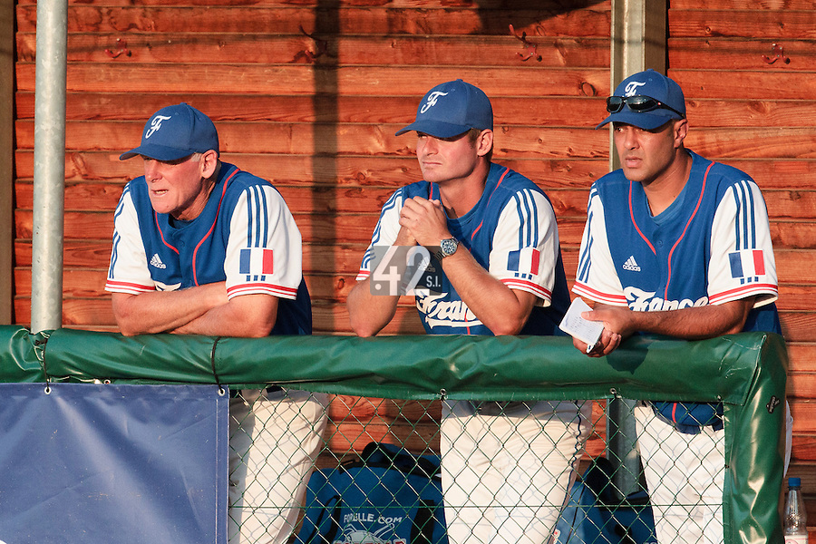 27 july 2010: Assistant coach John Haar, pitching coach Jeff Zeilstra and Team Manager Sylvain Virey, of France, are seen in the dugout during Germany 10-9 victory over France, in day 5 of the 2010 European Championship Seniors, in Stuttgart, Germany.