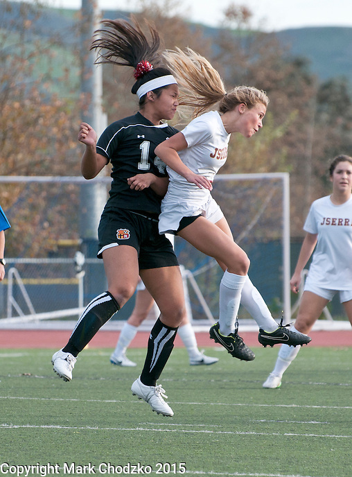 JSerra's Skylar Giacobetti and Rosary's Jazmin Valente fly towards the ball in Tuesday's game.