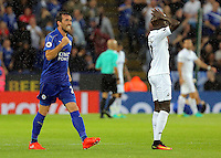 Pictured (L-R): Christian Fuchs of Leicester City cheers on as his team won a penalty and Modou Barrow of Swansea City vents his frustration Saturday 27 August 2016<br /> Re: Swansea City FC v Leicester City FC Premier League game at the King Power Stadium, Leicester, England, UK