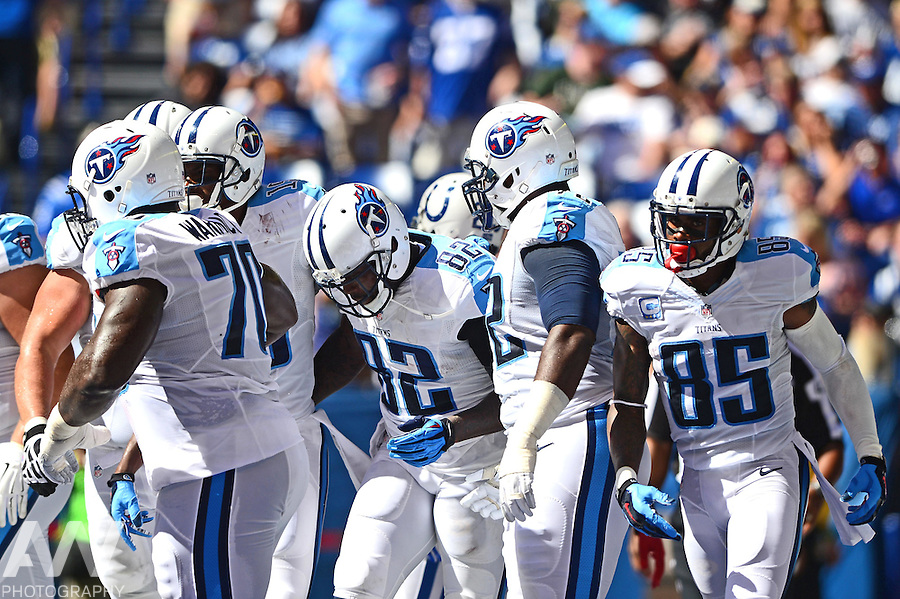 Sep 28, 2014; Indianapolis, IN, USA; Tennessee Titans tight end Delanie Walker (82) is congratulated by teammates after catching a pass for a touchdown during the second quarter against the Indianapolis Colts at Lucas Oil Stadium. Mandatory Credit: Andrew Weber-USA TODAY Sports