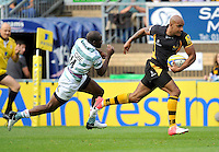 High Wycombe, England. Tom Varndell of London Wasps charges forward for a try during the Aviva Premiership match between London Wasps and London Irish at Adams Park on September,15 2012 in High Wycombe, England.