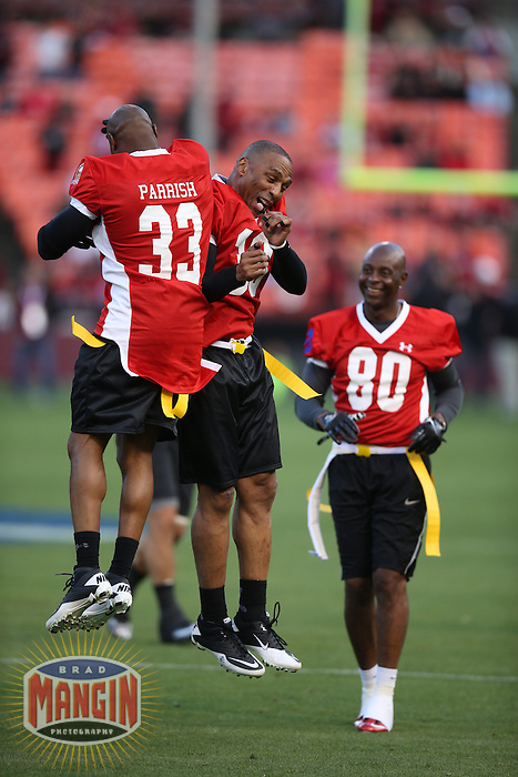 SAN FRANCISCO, CA - JULY 12:  Former San Francisco 49ers greats Tony Parrsh, Roger Craig, and Jerry Rice celebrate after a first half touchdown during the Legends of Candlestick flag football game at Candlestick Park in San Francisco, California on July 12, 2014. Photo by Brad Mangin