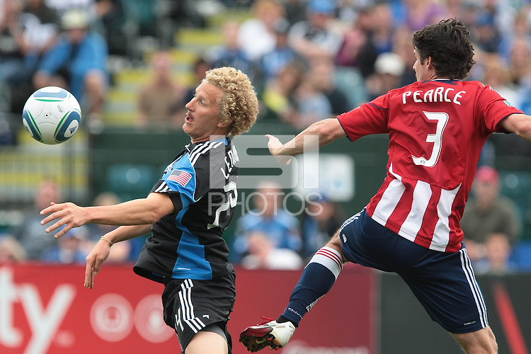 Steven Lenhart (left) controls the ball against Heath Pearce (3). Chivas USA defeated the San Jose Earthquakes 2-1 at Buck Shaw Stadium in Santa Clara, California on April 23rd, 2011.