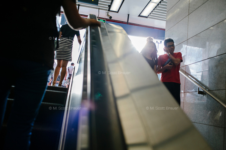 People walk in a pedestrian underpass in Xian, Shaanxi, China.
