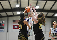 Elkins center Tiara Jackson (54) shoots, Friday, February 14, 2020 during a basketball game at Elkins High School in Elkins. Check out nwaonline.com/prepbball/ for today's photo gallery.<br /> (NWA Democrat-Gazette/Charlie Kaijo)