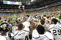 26 December 2010:  FIU kicker Jack Griffin (38) is lifted into the air by teammates after he kicked the game-winning field goal as time expired as the FIU Golden Panthers defeated the University of Toledo Rockets, 34-32, to win the 2010 Little Caesars Pizza Bowl at Ford Field in Detroit, Michigan.