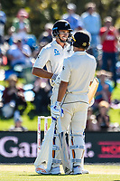 Neil Wagner congradulates Tim Southee of the Black Caps on getting to 50 runs during Day 3 of the Second International Cricket Test match, New Zealand V England, Hagley Oval, Christchurch, New Zealand, 1st April 2018.Copyright photo: John Davidson / www.photosport.nz