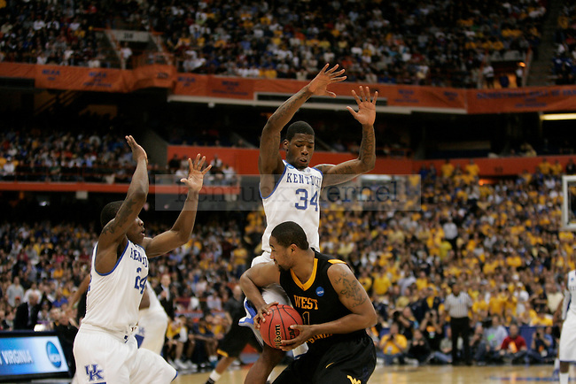 UK attempts to press West Virginia at the Carrier Dome on Saturday, March 27, 2010. The cats efforts fell short as the mountaineers won 73-66. Photo by Scott Hannigan | Staff