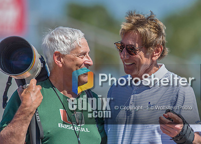 6 March 2016: Getty photographer Joel Auerbach reminisces with football legend Joe Namath prior to a Spring Training MLB game between the Washington Nationals and the Saint Louis Cardinals at Roger Dean Stadium in Jupiter, Florida. Auerbach shared photos with Namath dating back to Namath's college days in the 1960s. Mandatory Credit: Ed Wolfstein Photo *** RAW (NEF) Image File Available ***