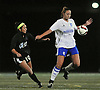 Nassau Team No. 18 Jen Wahlig (Clarke HS), right, gets pressured by Suffolk Team No. 10 Krystina Rodriguez (Patchogue-Medford HS) during the first of two Long Island varsity girls' soccer senior all-star games at Bethpage High School on Friday, November 27, 2015.<br /> <br /> James Escher