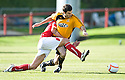 Alloa's Martin Grehan is bundled over by Brechin's Ewan Moyes ...