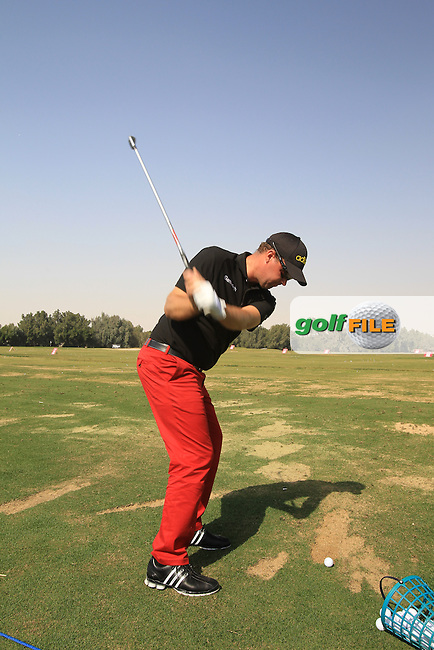 Peter Hanson (SWE) on the practice range during Tueday's Practice Day of the Commercial Bank Qatar Masters 2013 at Doha Golf Club, Doha, Qatar 22nd January 2013 .Photo Eoin Clarke/www.golffile.ie