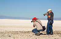 Photographing selenite crystals at Lake Lucero which is contained within the White Sands National Monument in  New Mexico. The lake is noted for the unusually high quantity of water-deposited and wind deposited gypsum dissolved in its intermittent waters. Annual evaporation cycles have caused much of the gypsum to precipitate into crystals of impure, brownish selenite that line the alkaline mudflats of the lakeshore. The further process of gypsum erosion abrades the fragile selenite, and other precipitated gypsum, into the pure-white sands covering most of the national monument.