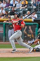 Tom Murphy (23) of the Albuquerque Isotopes follows through on his swing against the Salt Lake Bees during the Pacific Coast League game at Smith's Ballpark on August 30, 2016 in Salt Lake City, Utah. The Bees defeated the Isotopes 3-2. (Stephen Smith/Four Seam Images)