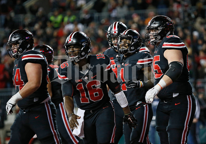 Ohio State Buckeyes teammates congratulate wide receiver Braxton Miller (1) on making a touchdown catch during the fourth quarter of NCAA football game against the Penn State Nittany Lions at Ohio Stadium in Columbus on Oct. 17, 2015. (Adam Cairns / The Columbus Dispatch)