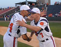 Head coach Jack Leggett (7) of the Clemson Tigers is congratulated by coach Dan Pepicelli (24) after the Tigers defeated the Elon College Phoenix on March 21, 2012, at Fluor Field at the West End in Greenville, South Carolina. Clemson's 4-2 win gave Leggett his 1,200th career win. (Tom Priddy/Four Seam Images)
