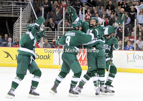 Bemidji State's Jamie MacQueen celebrates his goal which broke a 2-2 tie during the third period. Bemidji State beat UNO 4-2 Friday night during the first round of the WCHA playoffs at Qwest Center Omaha. (Photo by Michelle Bishop)