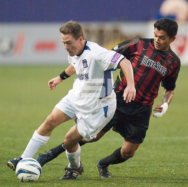 Richard Mulrooney of the Earthquakes is marked by Amado Guevara of the MetroStars. The San Jose Earthquakes and the the NY/NJ MetroStars played to a 4-4 tie on 7/02/03 at Giant's Stadium, NJ..