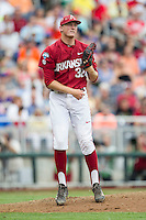 Arkansas Razorbacks pitcher Zach Jackson (32) in action against the Virginia Cavaliers in Game 1 of the NCAA College World Series on June 13, 2015 at TD Ameritrade Park in Omaha, Nebraska. Virginia defeated Arkansas 5-3. (Andrew Woolley/Four Seam Images)