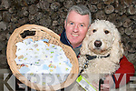 PUPPY LOVE: Killorglin Guide Dog Puppy Walker Patrick Foley with Chad and the thousands of stamps which will assist the work of the Irish Guide Dogs.   Copyright Kerry's Eye 2008