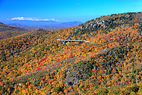 View of autumn colors on Grandfather Mountain with Linn Cove Viaduct in the background