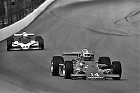 INDIANAPOLIS, IN - MAY 25: AJ Foyt (#14 Parnelli VPJ6C/Cosworth) drives ahead of Tom Bagley (#40 Wildcat IV/Cosworth) during practice for the Indy 500 on May 25, 1980, at the Indianapolis Motor Speedway in Indianapolis, Indiana.