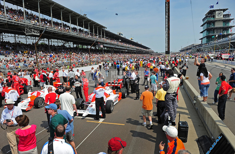 May 24, 2009; Indianapolis, IN, USA; IRL cars are lined up on the track prior to the 93rd running of the Indianapolis 500 at Indianapolis Motor Speedway.  Mandatory Credit: Mark J. Rebilas-