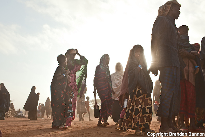 Kenya/Somali refugees.  Recent refugee arrivals from Somalia assemble into line  at Ifo camp. UNHCR/ Brendan Bannon/ August 2011
