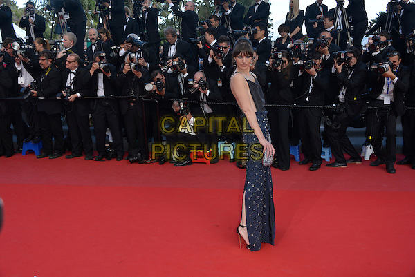 Milla Jovovich.'Cleopatra' premiere at the 66th  Cannes Film Festival, France..21st May 2013.full length blue black dress skirt top sleeveless beads beaded embellished jewel encrusted silver clutch bag photographers side .CAP/PL.©Phil Loftus/Capital Pictures.