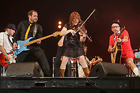 Cowboys Fringuants performs on the main stage of the Festival d'ete de Quebec (FEQ) in Quebec city Tuesday July 11, 2017.