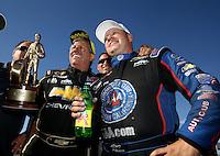 Apr 12, 2015; Las Vegas, NV, USA; NHRA funny car driver John Force (left) celebrates with teammate Robert Hight after winning the Summitracing.com Nationals at The Strip at Las Vegas Motor Speedway. Mandatory Credit: Mark J. Rebilas-