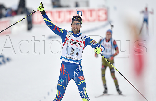 03.03.2016. Holmenkollen, Oslo, Norway.  Martin Fourcade of France celebrates after winning the mixed relay competition with the French team at the Biathlon World Championships, in the Holmenkollen Ski Arena, Oslo, Norway, 03 March 2016.