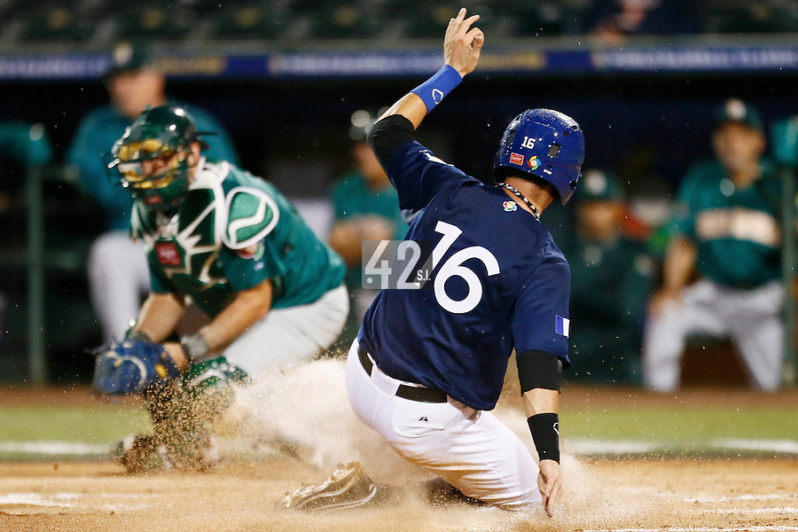 21 September 2012: Emmanuel Garcia scores a run during France vs South Africa tie game 2-2, rain delayed at the end of the 9th inning at 1 AM, during the 2012 World Baseball Classic Qualifier round, in Jupiter, Florida, USA. Game to resume 22 September 2012 at noon.