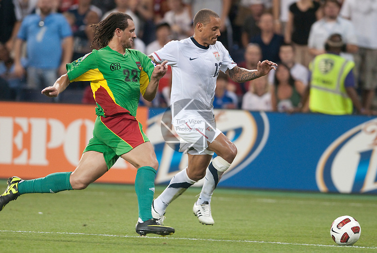 14 June 2011                          Guadeloupe defender Mickael Tacalfred (22) and USA midfielder Jermaine Jones (13) race after the ball in the second half. The USA Men's National Soccer Team defeated the Guadeloupe Men's National Soccer Team 1-0 in the first qualifying round of the CONCACAF Gold Cup game at Livestrong Sporting Park in Kansas City, KS on June 14, 2011.