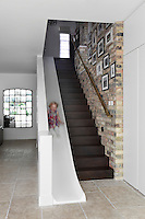 As demonstrated with the children's play area in the kitchen and this staircase slide, this house has been designed as much around the young as it has the adults