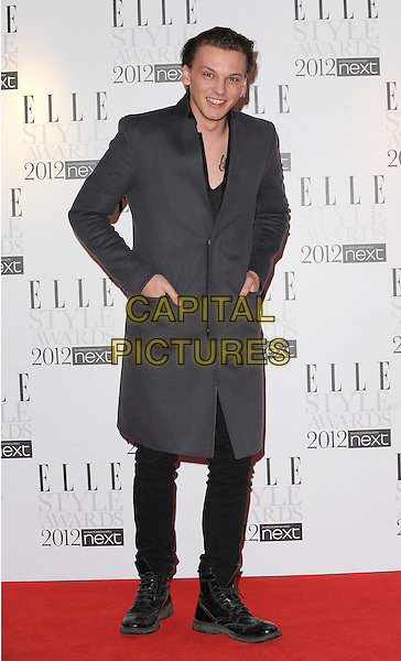 Jamie Campbell Bower.The ELLE Style Awards 2012, Savoy Hotel, London, England,.February 13th, 2012.full elngth coat hands in pockets grey gray.CAP/BEL.©Tom Belcher/Capital Pictures.