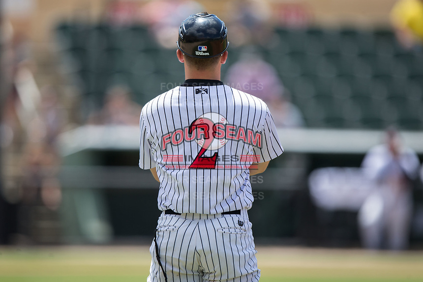 Tyler Sullivan (2) of the Kannapolis Intimidators coaches first base during the game against the West Virginia Power at Kannapolis Intimidators Stadium on June 18, 2017 in Kannapolis, North Carolina.  The Intimidators defeated the Power 5-3 to win the South Atlantic League Northern Division first half title.  It is the first trip to the playoffs for the Intimidators since 2009.  (Brian Westerholt/Four Seam Images)