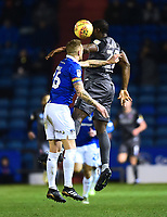Lincoln City's John Akinde vies for possession with Oldham Athletic's Peter Clarke<br /> <br /> Photographer Andrew Vaughan/CameraSport<br /> <br /> The EFL Sky Bet League Two - Oldham Athletic v Lincoln City - Tuesday 27th November 2018 - Boundary Park - Oldham<br /> <br /> World Copyright © 2018 CameraSport. All rights reserved. 43 Linden Ave. Countesthorpe. Leicester. England. LE8 5PG - Tel: +44 (0) 116 277 4147 - admin@camerasport.com - www.camerasport.com