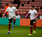 John Egan of Sheffield Utd and John Fleck of Sheffield Utd warm up in heads up t-shirts during the Premier League match at Bramall Lane, Sheffield. Picture date: 9th February 2020. Picture credit should read: Simon Bellis/Sportimage
