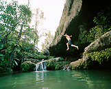 Madagascar, man jumping into pool, Isalo National Park
