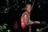 Lolgorian, Kenya. Siria Maasai; Eunoto ceremony; moran in the forest collecting white ochre for body paint.