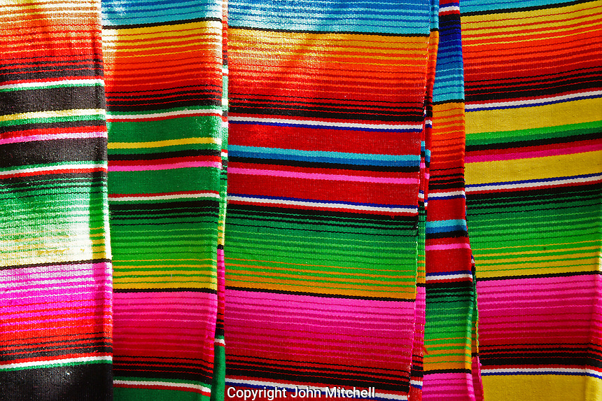 Colorful Mexican blankets in Mercado 28 souvenirs and handicrafts market in  Cancun, Mexico      .