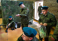 Young conscripts who have just arrived at the military base put on their new army uniforms. This year's class of drafted recruits is the final one after 90 years of compulsory military service, as Poland's army turns professional in 2009.