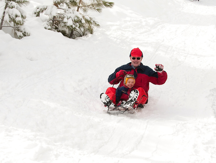 California, Lake Tahoe: Grandpa and grandchild enjoy snow play with sled at North Lake Tahoe Regional Park.  Photo copyright Lee Foster.  Photo # cataho107680