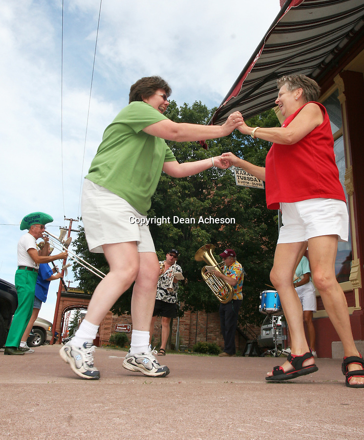 A summer festival in Calumet, Mich., includes a sidewalk band and dancing.