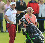 Damien McGrane with his mum Attracta as caddy after chipping onto the 18th green during the Final Day of the 100th Irish PGA Championship at Seapoint Golf Club, Co. Louth, 26th September 2010..(Picture Eoin Clarke/www.golffile.ie)