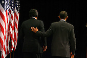 Chicago, IL - December 3, 2008 -- United States President-elect Barack Obama (R) pats Secretary of Commerce designee and New Mexico Governor Bill Richardson on the back after a news conference in Chicago on December 3, 2008. .Credit: Brian Kersey - Pool via CNP