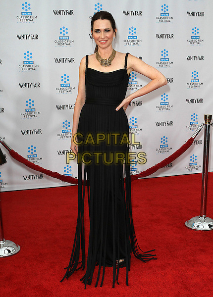 Janie Bryant.2012 TCM Classic Film Festival Opening Night Gala Held at Grauman's Chinese Theatre, Hollywood, California, USA..April 12th, 2012.full length black dress fringed tassels hand on hip.CAP/ADM/KB.©Kevan Brooks/AdMedia/Capital Pictures.