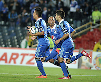 BOGOTA - COLOMBIA – 21-08-2014: Los jugadores de Millonarios de Colombia celebran el gol anotado a Universidad Cesar Vallejo C. F. de Peru, durante partido de ida de la primera fase, llave G14 de la Copa Total Suramericana entre Millonarios de Colombia y Universidad Cesar Vallejo Club de Futbol de Peru, en el estadio Nemesio Camacho El Campin de la ciudad de Bogota. / The  players of Millonarios of Colombia, celebrate a goal scored to Universidad Cesar Vallejo C. F of Peru, during a match for the first leg, of the first phase, Key G14 between Millonarios de Colombia and Universidad Cesar Vallejo Club de Futbol of Peru of the Copa Total Suramericana in the Nemesio Camacho El campin Stadium in Bogota city. Photos: VizzorImage / Luis Ramirez / Staff.